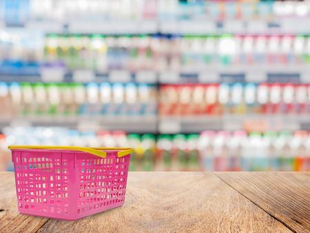 shelf: Basket and wood floor on shelf supermarket blurred background