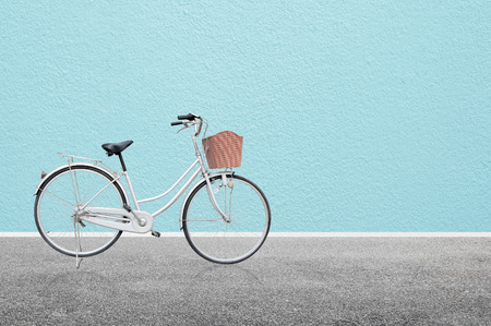 blue wall: Bicycle on road and blue wall abstract background , retro vintage style