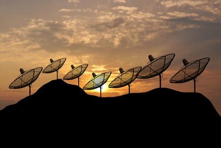 antenna: Sunset Silhouette  Satellite dish on hill Stock Photo