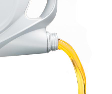 Pouring motor oil on white background Foto de archivo