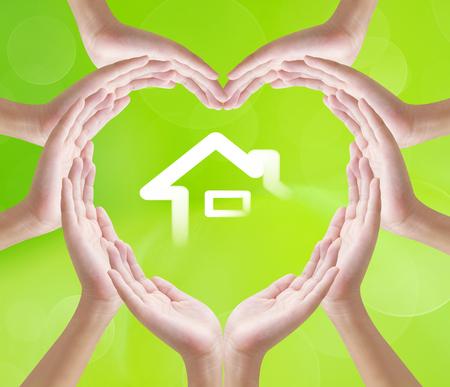 heart hands: Hands heart shape on home background