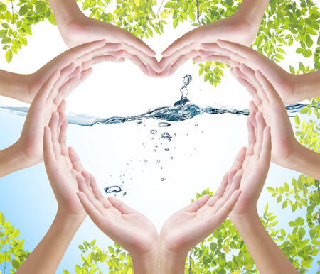 safe drinking water: Hand heart shape on nature water backgrround