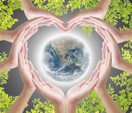planet earth: Hand heart shape and earth on dark background , concept design , Elements of image are furnished by NASA Stock Photo