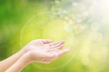 Hand on bokeh background