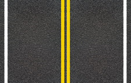 granular: Road asphalt with  yellow and dashed white stripe