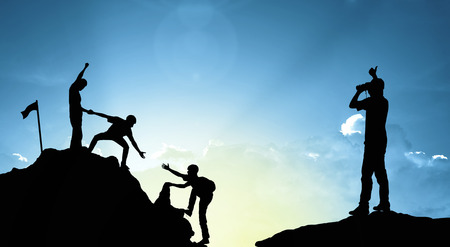 team cooperation: climbing helping  team work , success concept