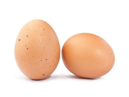 Two brown eggs on white background