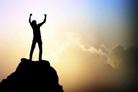 winner man: Man on the peak of mountain and sunlight , success,winner, leader concept