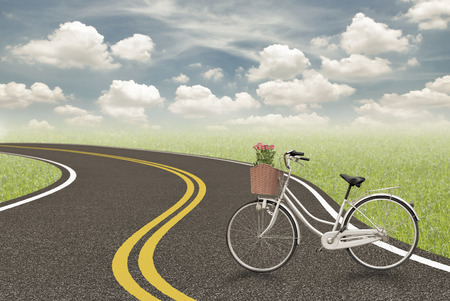 road to love: Bicycle and rose in basket on the road , love concept