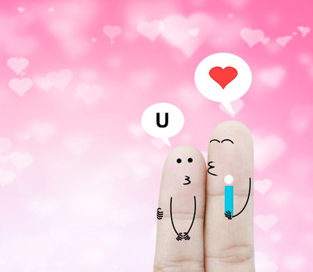 chat box: Couple finger holding flower and chat box on pink heart bokeh background , holiday abstract background