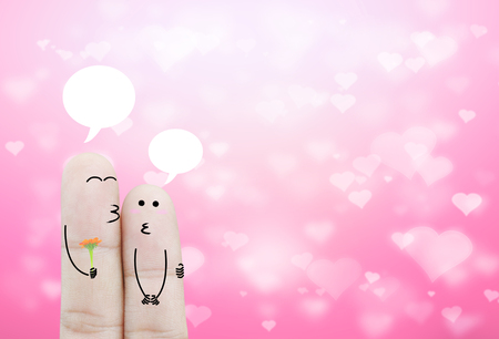 chat box: Couple finger holding flower and chat box  on bokeh pink heart background