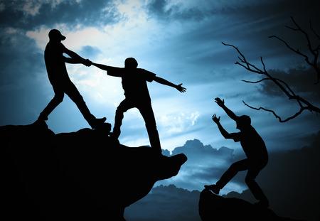 climbing helping team work , success concept Foto de archivo