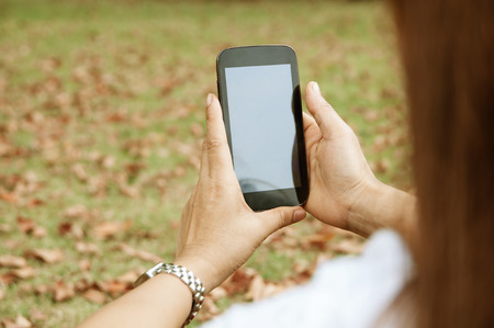 medow: Adult woman holding smart phone