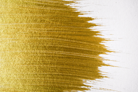 Gold acrylic paint texture on white paper background art object design Foto de archivo