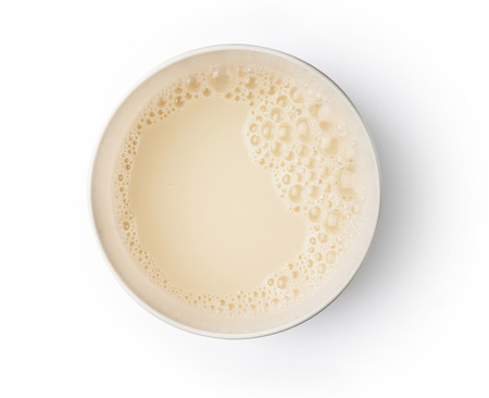 Cup with soy milk bubble foam on top view texture background object design