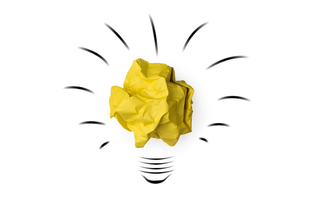 white achievement: Yellow paper crumpled lightbulb shape isolated on white background  idea business innovate achievement concept