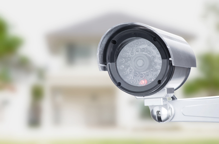 CCTV camera ccd lens security  on house home blure background Stock Photo