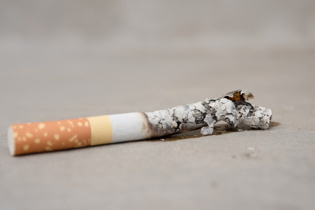 no shirt: Close up cigarette burning on concrete floor , stop quitting tobacco concept