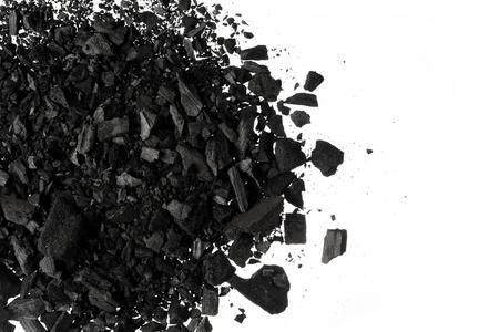 Pile of Carbon charcoal  dust on white background Foto de archivo