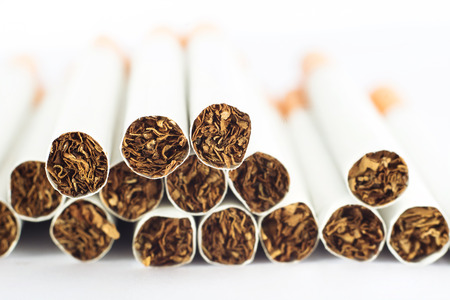 Heap of cigarettes on white background Stock Photo