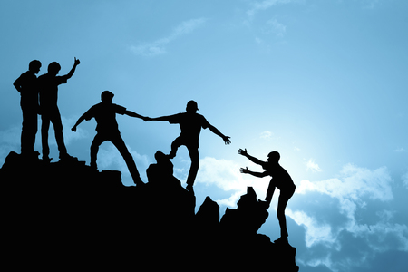 Group of people on peak mountain climbing helping team work , success concept