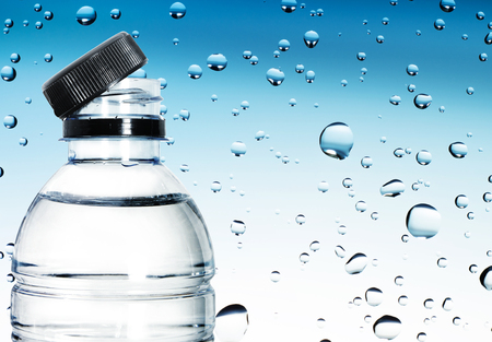 Bottle of water and water drop background