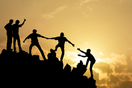 Group of people on peak mountain  climbing helping team work , success concept Stock Photo