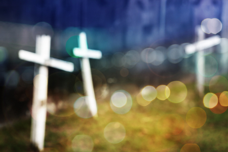Cross blur bokeh background Stock Photo