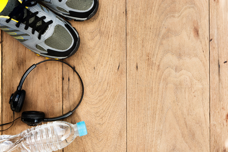 Sport shoes,sneaker and bottle of water on wooden background ,sport equipment top view