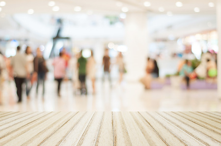 empty warehouse: Wood floor with blurred people in shopping mall for background