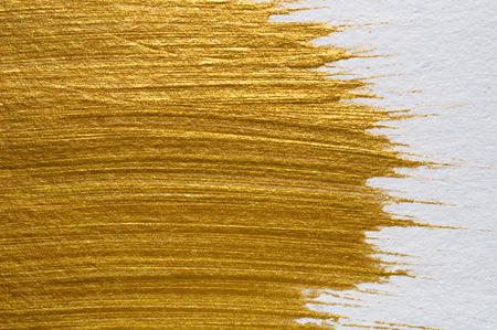 foil: Gold acrylic paint on white paper background , gold texture free hand stoke object paint Stock Photo