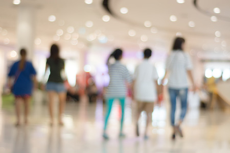 empty warehouse: Blurred bokeh and people in shopping mall for background Stock Photo