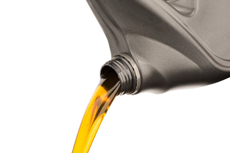 Pouring oil lubricant motor car from gray bottle on isolated white background Foto de archivo - 112894775