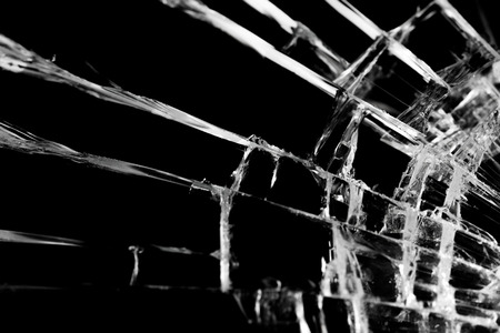 Broken glass craked on black background ,selective focus texture object design