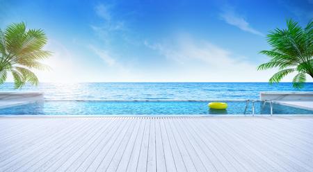Estate di rilassamento, piattaforma prendente il sole e piscina privata con la spiaggia vicina e vista panoramica del mare alla rappresentazione di lusso casa / 3d Archivio Fotografico