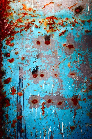 The old metal plate covered with an old blue paint, with rust inclusion  photo