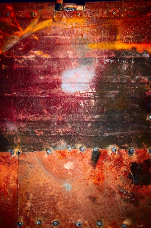 scrap iron: Red-yellow colors of a rust with welding inclusion Stock Photo