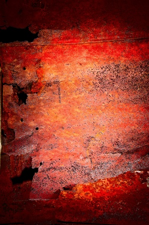 Red rust upon rotten metal photo