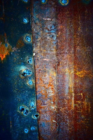 Old metal plates covered with beautiful divorces and fastened among themselves welding photo