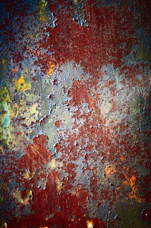 Red color of a rust with a shabby colourful covering photo