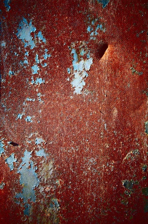 Red color of a rust with a shabby colourful covering