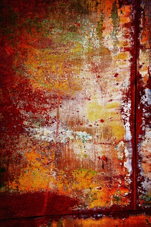 Red-yellow colors of a rust with a shabby colourful covering photo