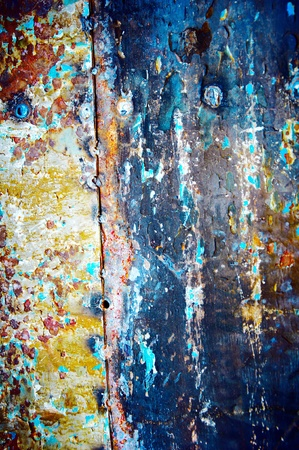Metal wall with a shabby colourful covering Stock Photo - 11137894