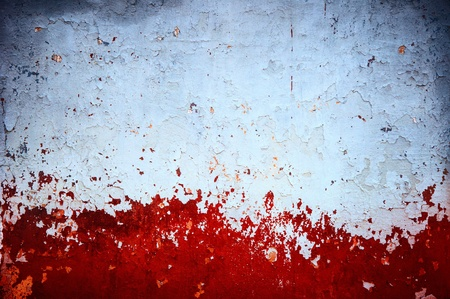 eroded: grunge red paint on wall background texture