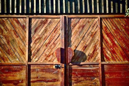 Brown gates as a background, made wooden boards photo