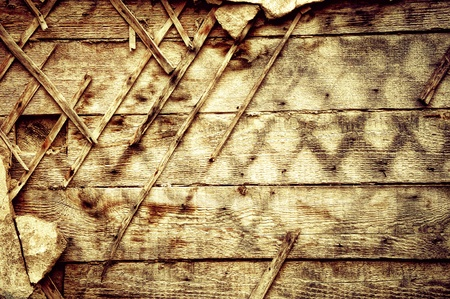 The destroyed old wall. Wooden texture in grunge background photo