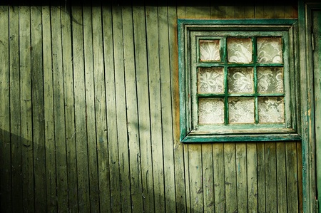 Wooden wall of green color, with a square window Vintage