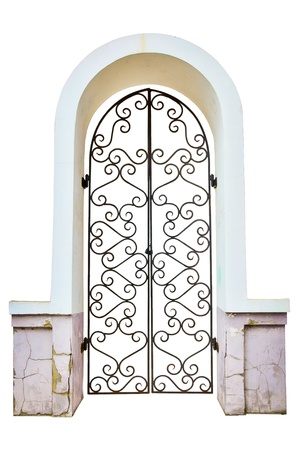 Facade an arch with the closed curly metal door. isolated Stock Photo