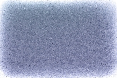 Background a texture. The old scratched cardboard in style grunge, blue color photo
