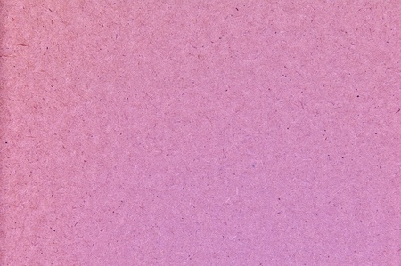 Background a texture. The old scratched cardboard in style grunge, pink color photo